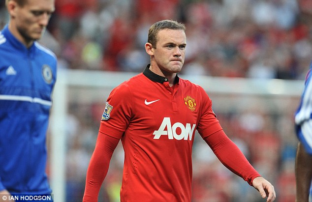 Decision time: Wayne Rooney walks out at Old Trafford to face Chelsea on Monday evening