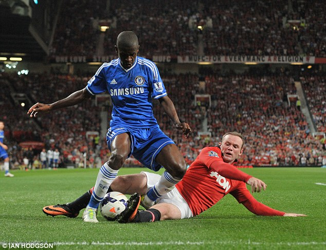 Battling back: Rooney slides in on Ramires (left) during the second half