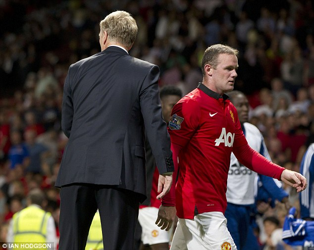 Staying or going? Rooney and manager David Moyes cross paths at the full-time whistle