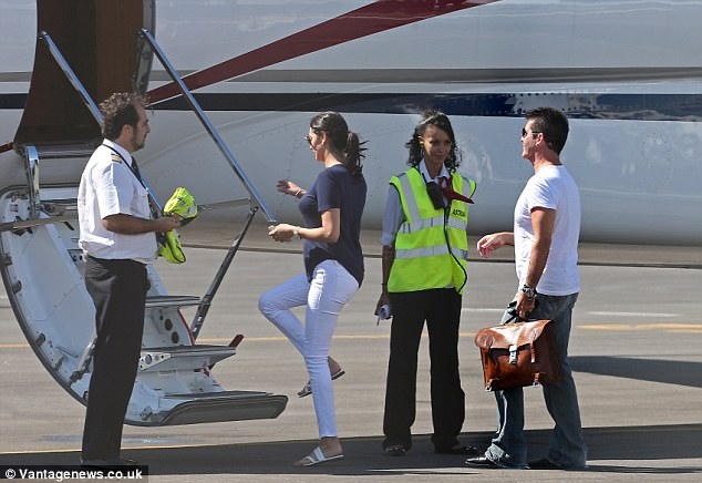 Travelling in style: It's believed Simon and Lauren are headed back to London following her short trip to France