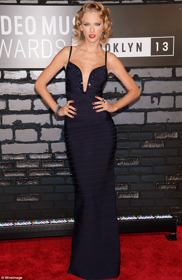 Showing Harry what he's missing: The leggy beauty was on her A game in a sexy slinky navy blue gown to attend the awards ceremony