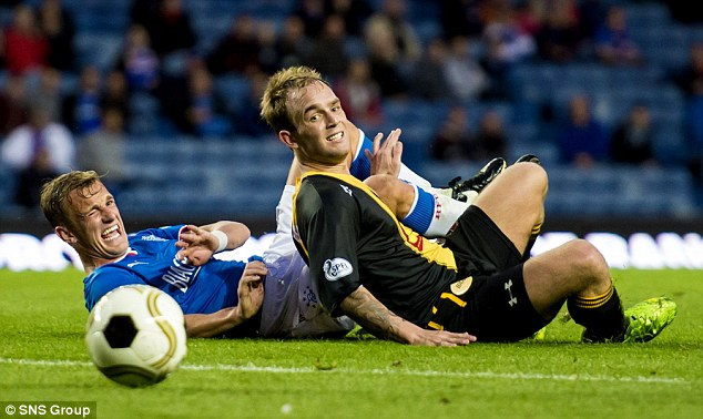 Agonising: Berwick's Devon Jacobs (right) does enough to put off Dean Shiels
