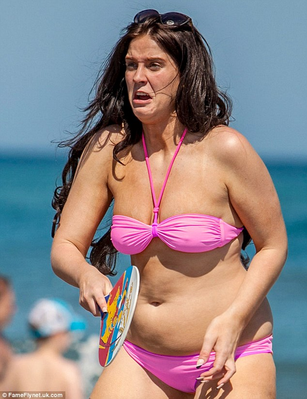 Vicki appears to be getting into it after hitting the beach in Marbella