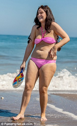 Vicki was in high spirits as she played bat and ball before taking a stroll along the beach