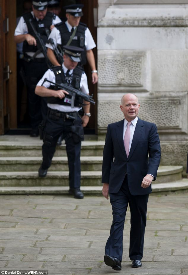 Summit: Foreign Secretary William Hague arrives at 10 Downing Street for a meeting with Prime Minister David Cameron this morning