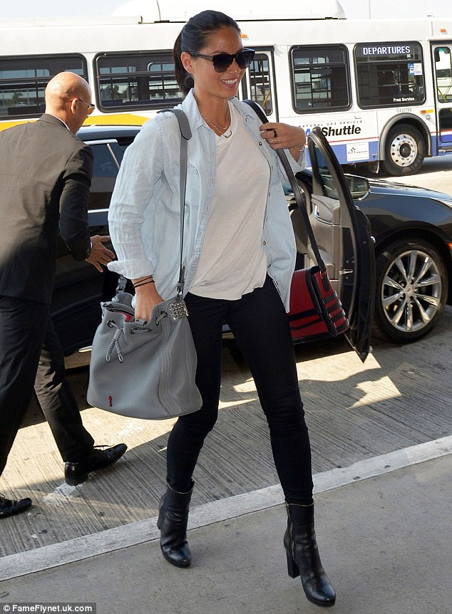 No fuss: The Magic Mike star went for a causal cool look showing off her slender legs in tight black jeans and a loose white T-shirt over which she wore a chambray shirt
