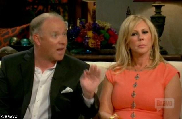 Talking: Brooks sat beside Vicki and tried to defend himself
