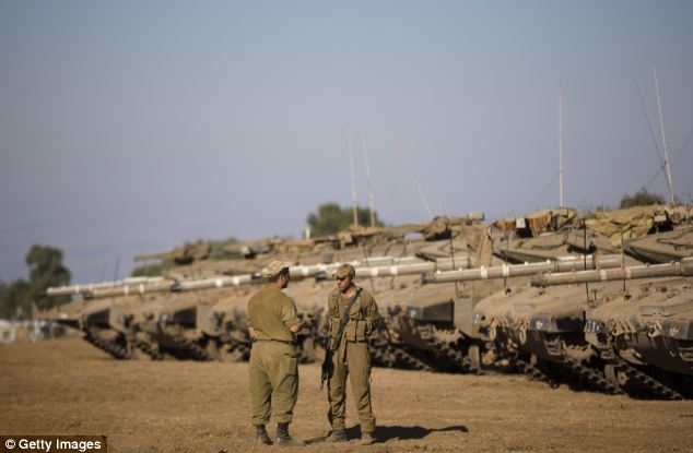 Soldiers stand guard as Israeli troops take part in a military exercise