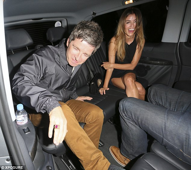 Happiness: The pair looked happier than ever as they emerged form their evening out in central London