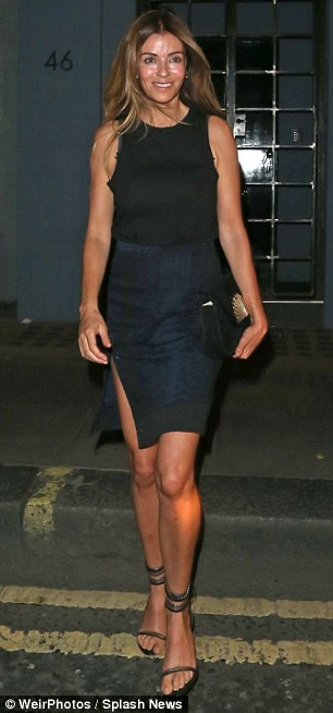 High spirits: The couple couldn't keep the grins off their faces as they emerged outside London hotspot Groucho at 1am
