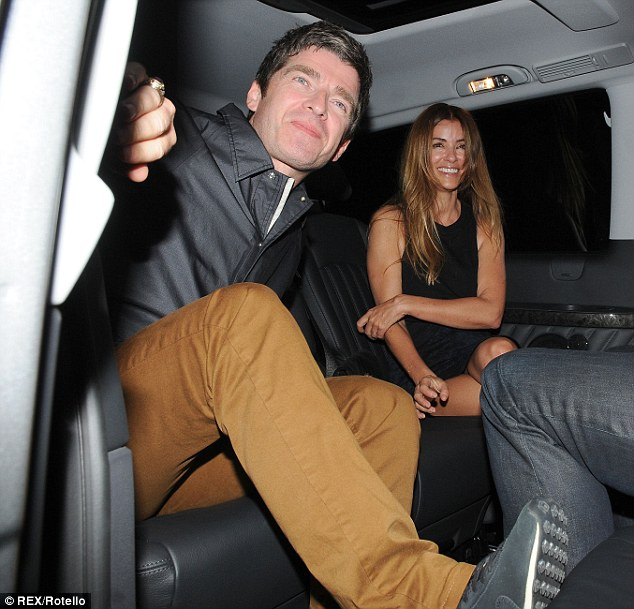 Good night then: Noel grinned as he showed off his style in a pair of brown chinos and a black jacket