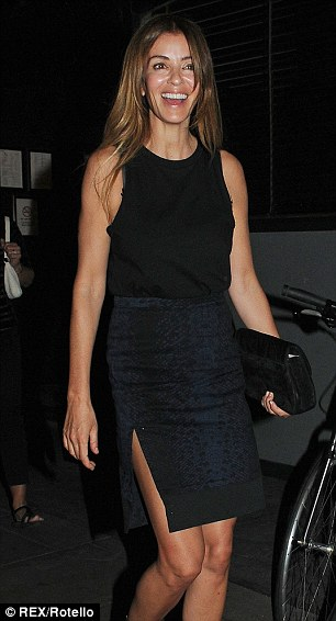Glowing: Sara dressed up in a pencil skirt with side split and a high neck top tucked in