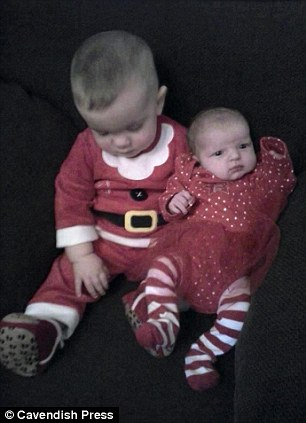 Family collect of Ruby (right) with her brother Logan in Christmas outfits
