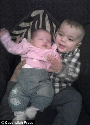Family photograph of Ruby and Logan
