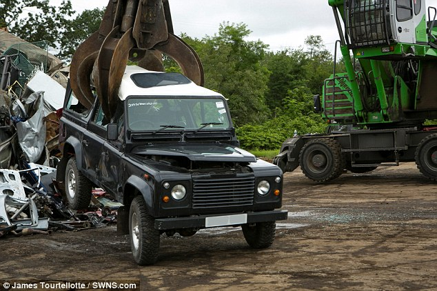 Gripping: The claw grips the exclusive vehicle, dramatically reducing its value from the £100,000 figure