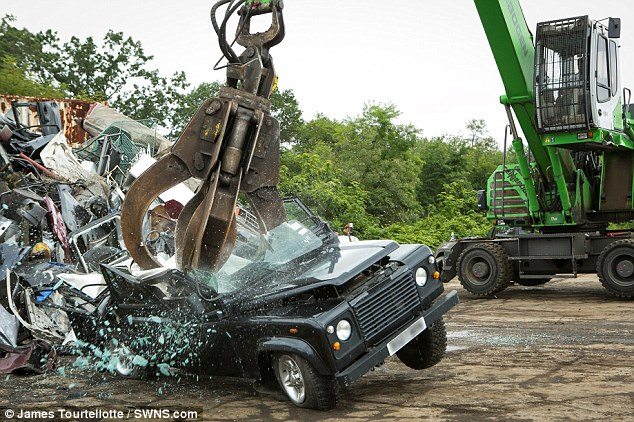 Crushed: The air is filled with breaking glass as the claw hammers down on the roof of the vehicle