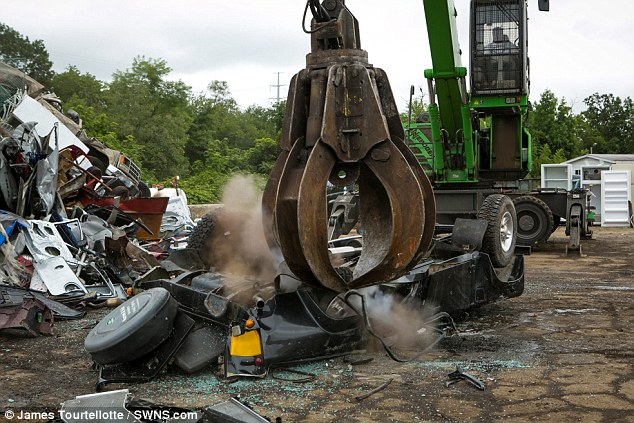 Crushed: The importers dreams of a big pay cheque lay in similar ruins to that of his once valuable car