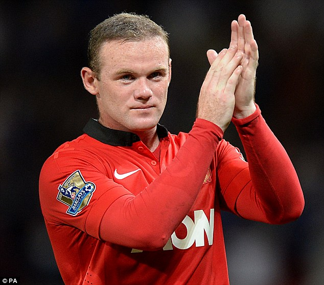 Lapping it up: Wayne Rooney applauds fans at Old Trafford on Monday night