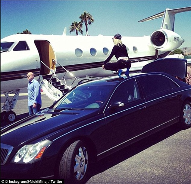 First class: Nicki Minaj twerking on her limo before boarding a private jet