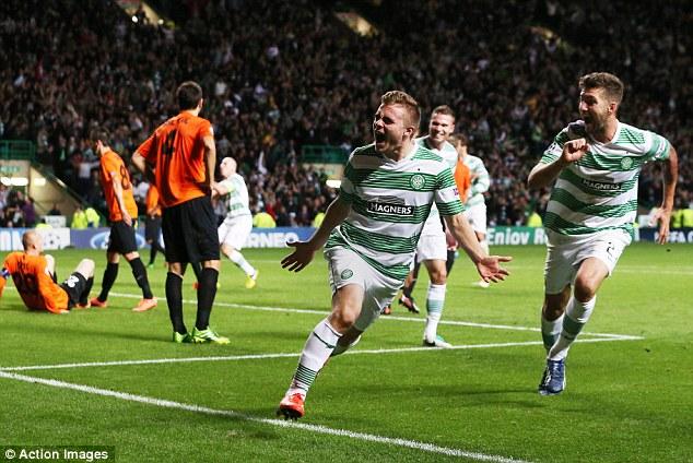 Hero: Forrest celebrates as Celtic Park goes wild