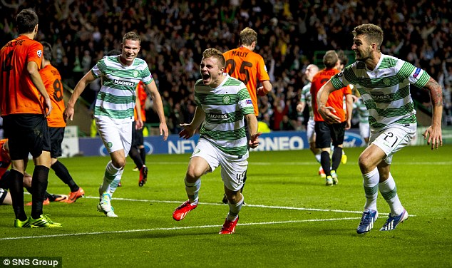 Roar: Forrest runs in delight after putting his side through to the Champions League group stages