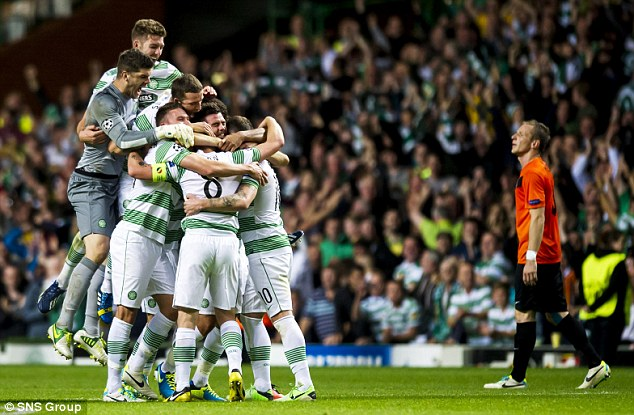 Huddle: Celtic players celebrate their win at full time