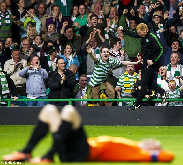 Jump for joy: Lennon celebrates after a wild run down the touchline
