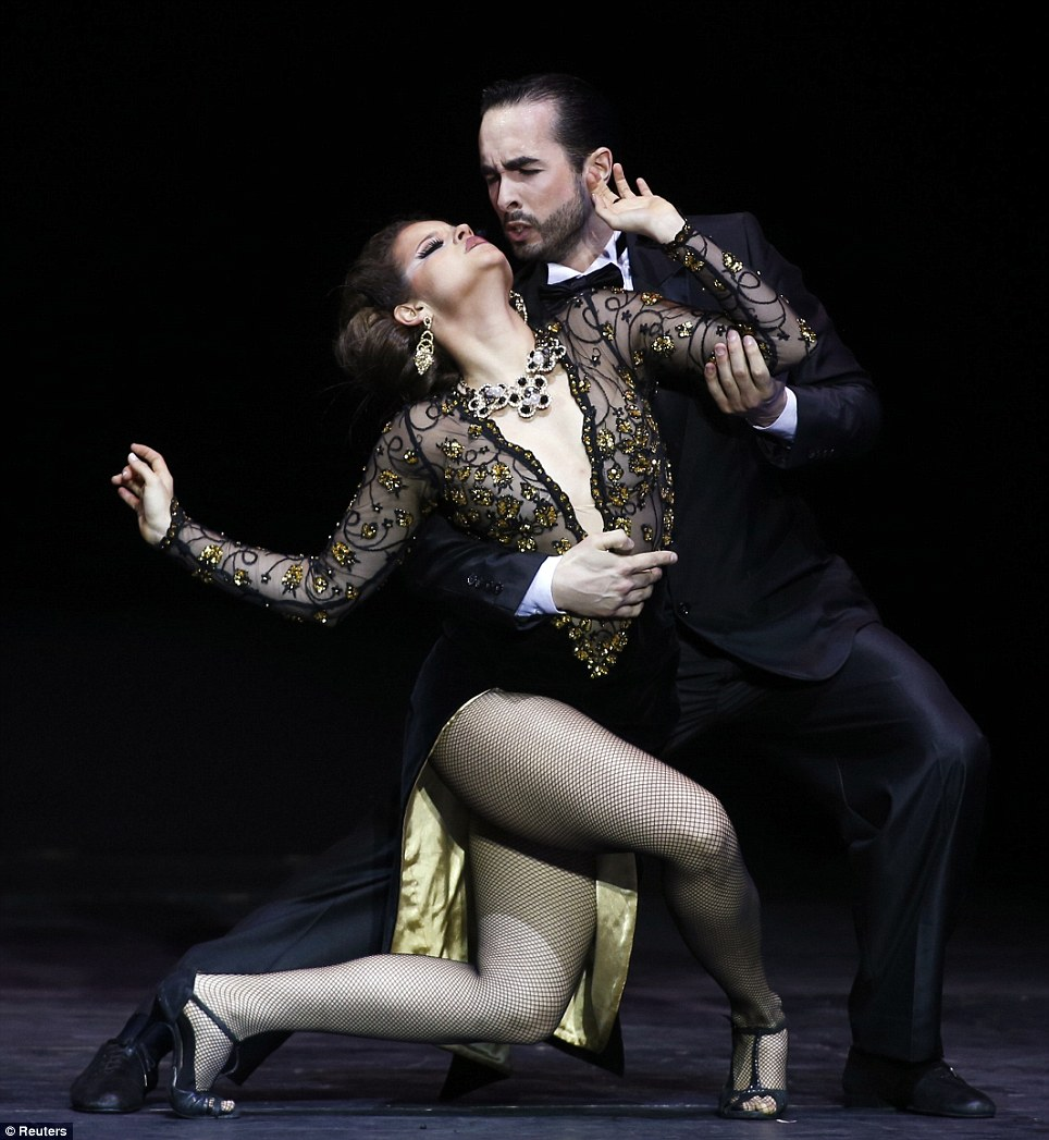 It takes two: Facundo Ruiz Diaz and Agostina Tarchini from Argentina compete in the Stage style event helt at the Luna Park arena in Buenos Aires