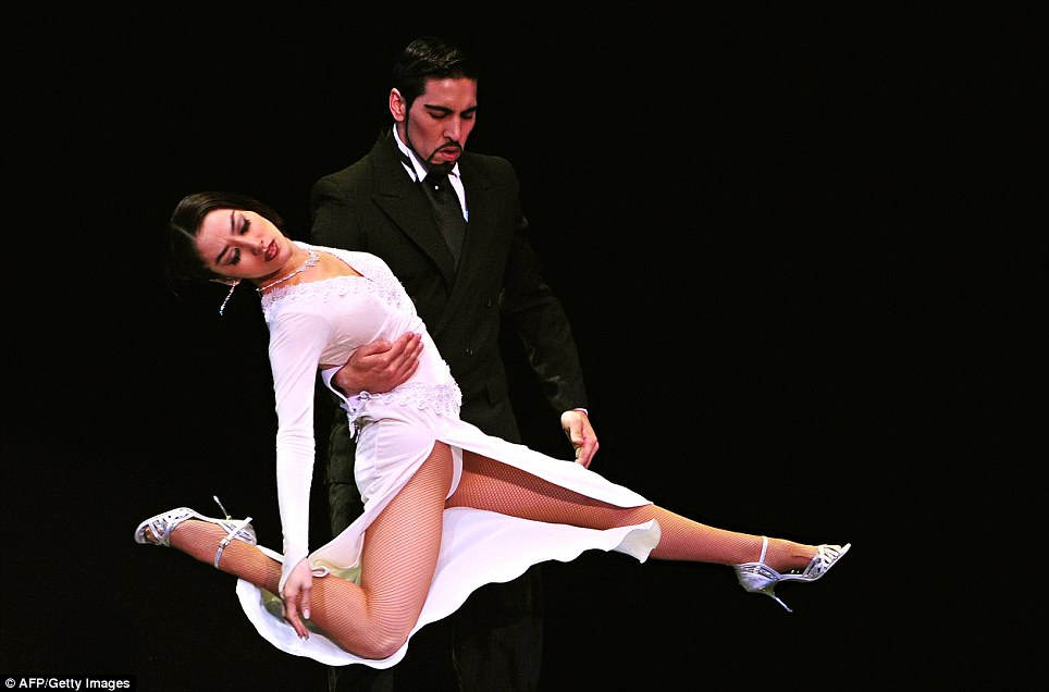 Argentina's Jos Luis Salvo and Yuki Misaki dance tango during the Stage Tango competition of the Tango World Championship in Buenos Aires