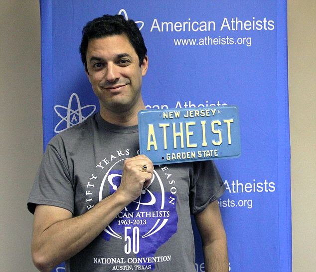 Error? Silverman applied knowing similar requests have been approved before. Here he is holding a vintage atheist plate. New Jersey officials said his denial was a 'clerical error'
