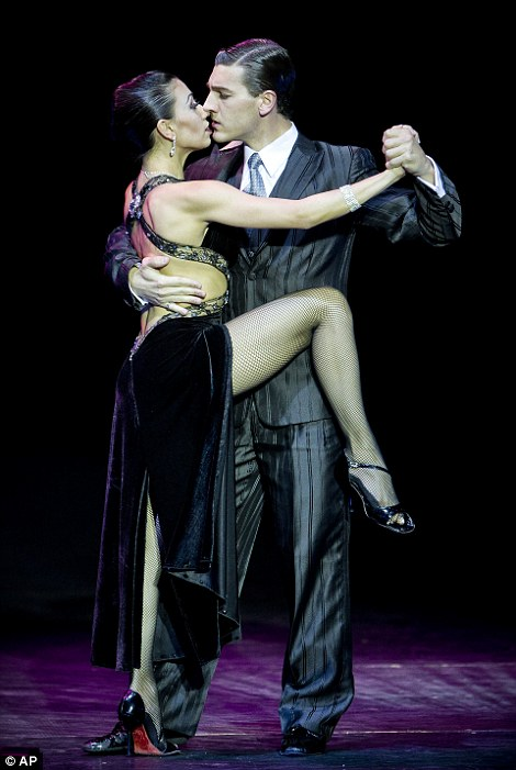 Stage cup winners Guido Palacios,  and Florencia Castilla, locked in another passionate embrace