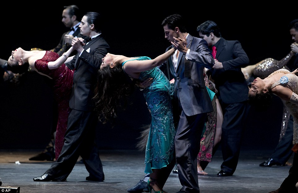 Couples perform together to the delight of the audience before the announcement of the winners of the 2013 Tango Dance World Cup stage finals in Buenos Aires
