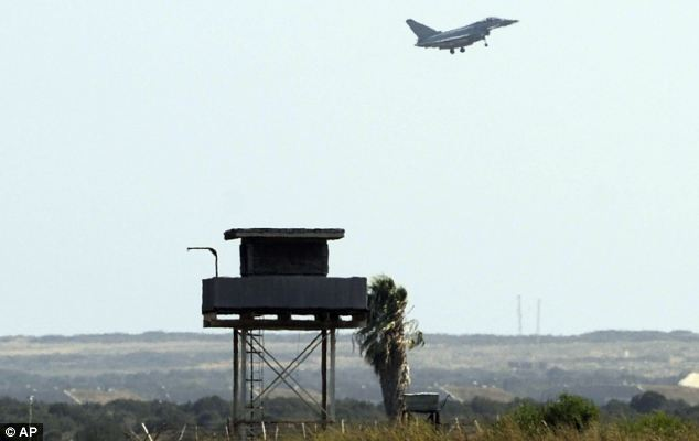 Prudent: An RAF Typhoon jet comes in to land at Akrotiri in Cyprus yesterday as a 'prudent and precautionary measure', the Ministry of Defence said
