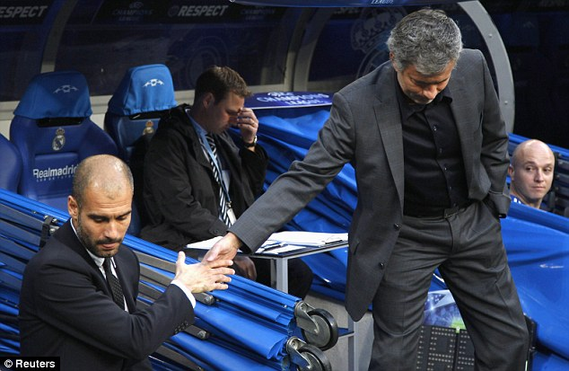 Handshake: Mourinho greets Guardiola ahead of the first leg of the Champions League semi-final between Real Madrid and Barcelona at the Bernabeu in 2011
