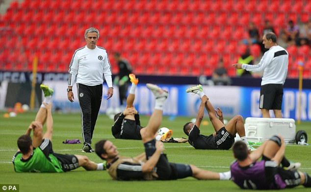 Preparation: Chelsea players stretch as Mourinho looks on