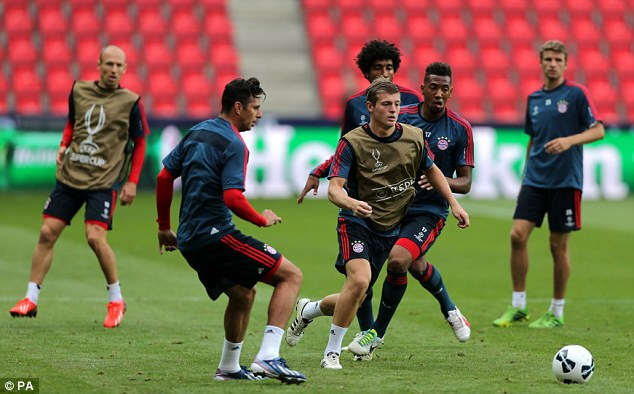 Chase: Bayern's Toni Kroos wins the ball during training