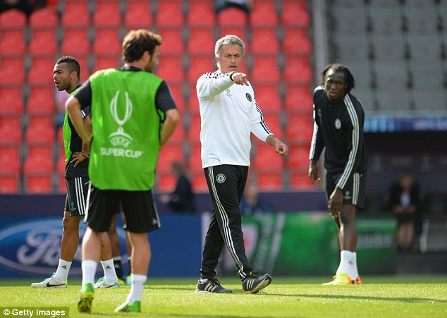 In charge: Mourinho shouts orders during a Chelsea training session ahead of the Super Cup final