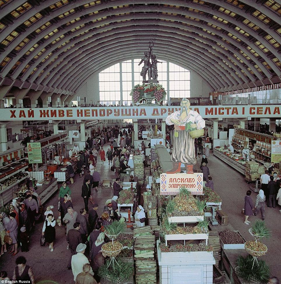 Land of plenty: A picture shows a market overflowing with fresh produce. The images document the country in the final year of Stalin's life
