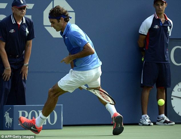 Hotdog: Federer plays a shot through his legs