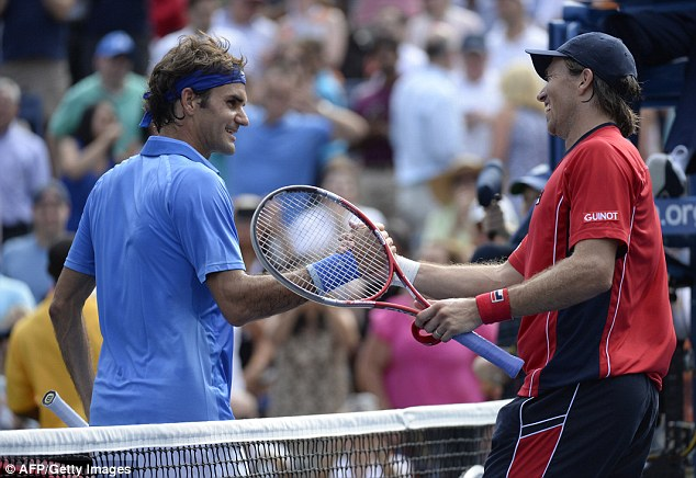 Handshake: Federer greets Berlocq after clinching victory