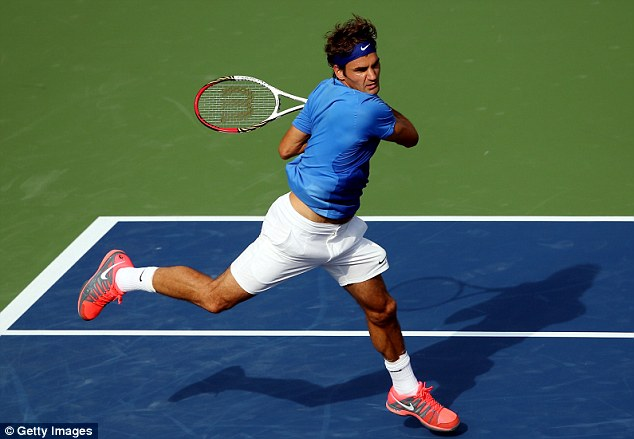 Grace: Federer plays a forehand during his second-round victory