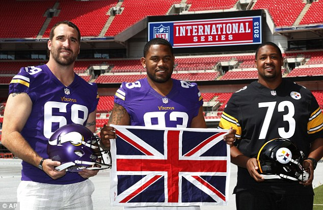 Head-to-head: Minnesota Vikings' Jared Allen and Kevin Williams pose at Wembley with the Pittsburgh Steelers' Ramon Foster