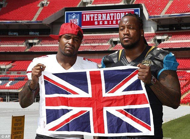 International series: the San Francisco 49ers' Donte Whitner (left) will face Uche Nwaneri and the Jacksonville Jaguars in October