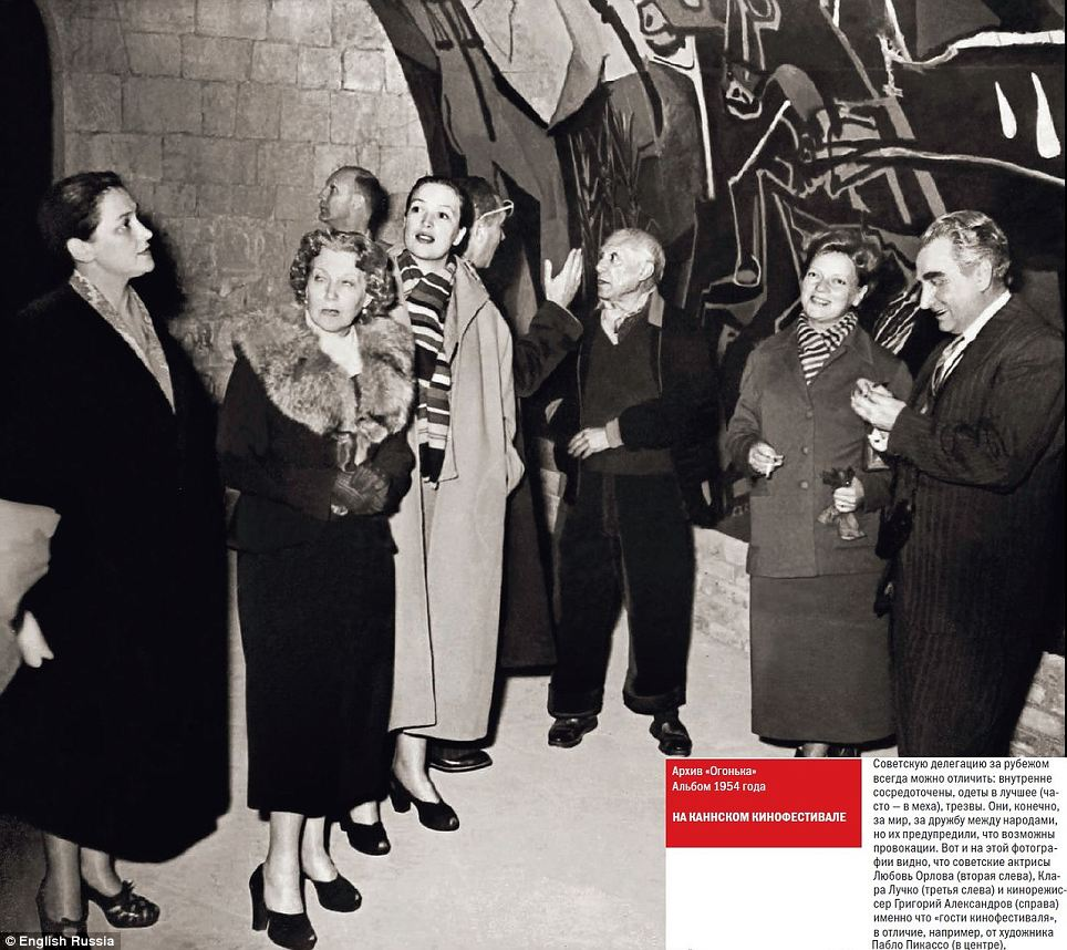 High society: These woman and men look suspiciously smartly dressed for what was, in theory, a strictly egalitarian communist country