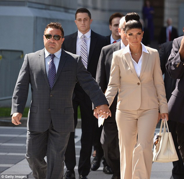 Seeking a handout: Teresa and Joe Giudice have sought donations from fans to pay for their legal defence, pictured in mid August leaving a court in Newark, New Jersey