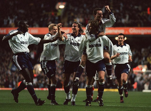 Mobbed: Tim Sherwood (third right) is congratulated after scoring from a free-kick in a rare Spurs win in 1999