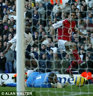 Thriller: Robert Pires shoots past Paul Robinson for the winning goal in Arsenal's remarkable 5-4 win in 2004