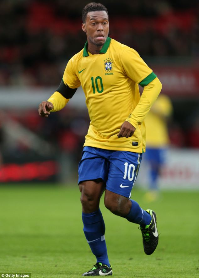 Samba style: Sturridge sports Brazil's famous yellow shirt in our mocked-up picture