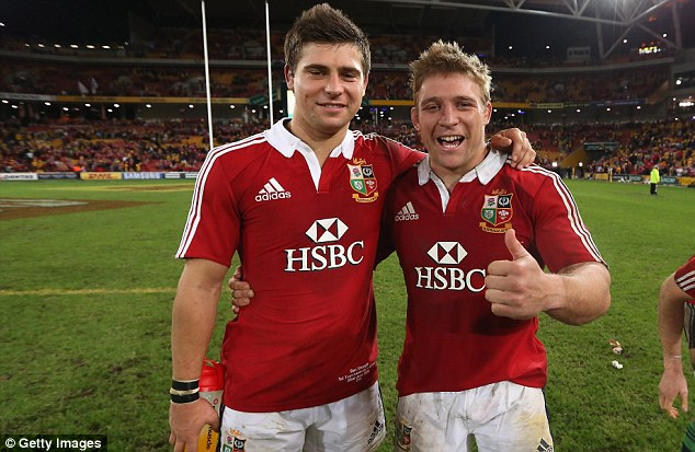 Proud Lions: Tom Youngs (right) and his brother Ben celebrate beating Australia this summer