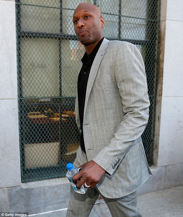 Troubling times: Lamar Odom, pictured in March, was reportedly involved in a 'three-way car collision' on the same freeway less than a week before his DUI address